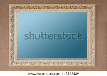 White with gilding empty picture frame - stock photo