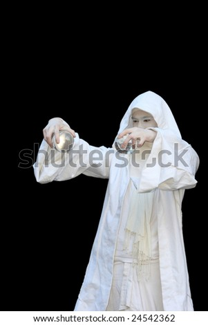 White Wizard manipulating crystal balls  isolated on black background - stock photo