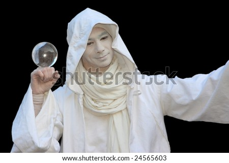 White Wizard manipulating Crystal balls  isolated on black background. - stock photo