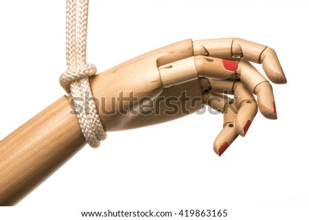 White woman hand attached on white rope in black background