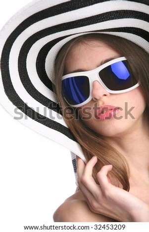 white woman in striped hat and black sunglasses - stock photo