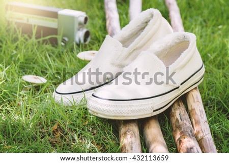 white women sneakers without laces in the garden - stock photo
