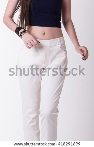 White women trousers,Focus on trousers. - stock photo
