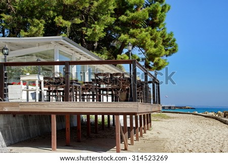 White Wood Seafood Restaurant And Outdoor Terrace On The Sea Beach - stock photo