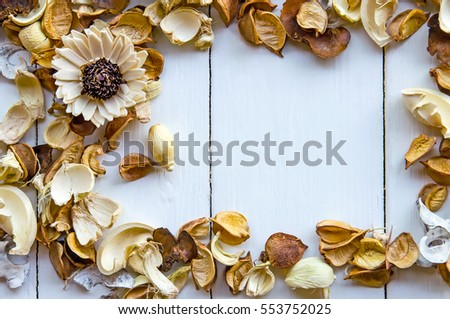 white wooden background of dry flower.