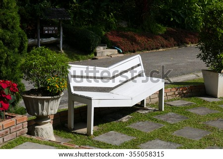 white wooden bench seat in the garden park