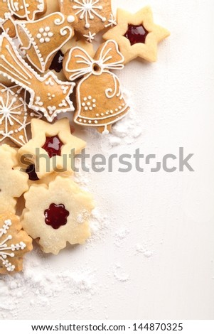 White wooden board and Christmas cookies.