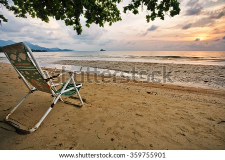White wooden  chairs on white sand beach at Phu Quoc island in Vietnam - stock photo