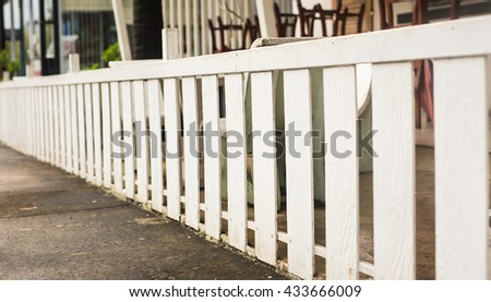 White wooden country style fence and small yard behind - stock photo