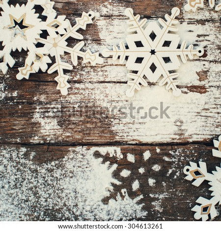 White Wooden Decorative Snowflakes on an Old Vintage Background, as the Christmas Decor - stock photo