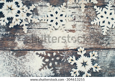 White Wooden Decorative Snowflakes on Old Vintage Background, as the Christmas Decor. Tinted photo - stock photo