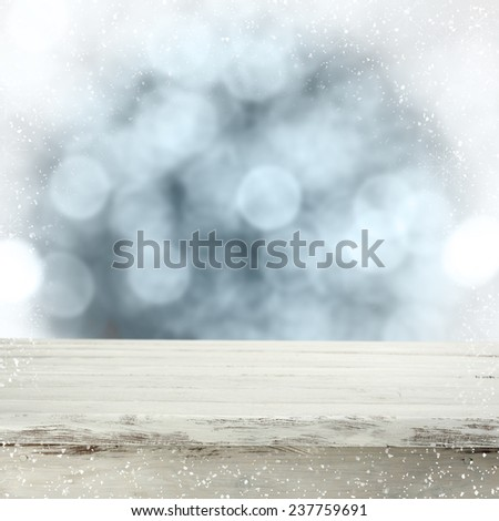 white wooden desk space and blue bokeh of winter  - stock photo