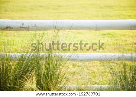White wooden fence in the farm - stock photo