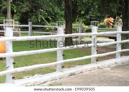 white wooden fence in the park - stock photo