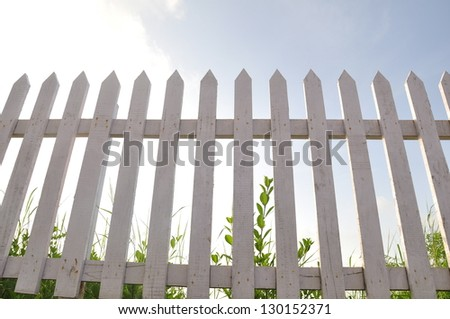 White wooden fence-low angle - stock photo