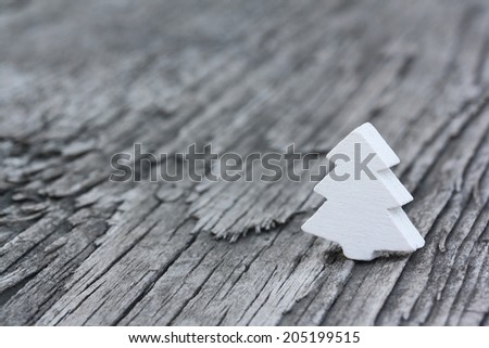 White wooden fir-tree on an old wooden background - stock photo