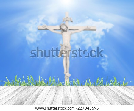 White wooden floor over blurred Jesus and the cross with world map of clouds background. Thanksgiving, Christmas, Worship, Forgiveness, Mercy, Repentance, Adoration, Glorify, Humble, Love concept - stock photo