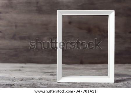 White wooden frame on grunge wood background - stock photo