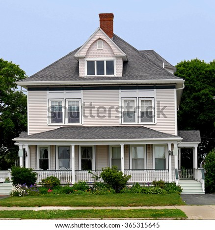 white wooden house with large porch