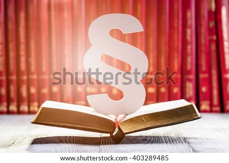 White wooden paragraph the symbol of law in court library with legal codes. Law concept - stock photo