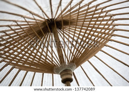White wooden parasol with shallow depth of field - stock photo