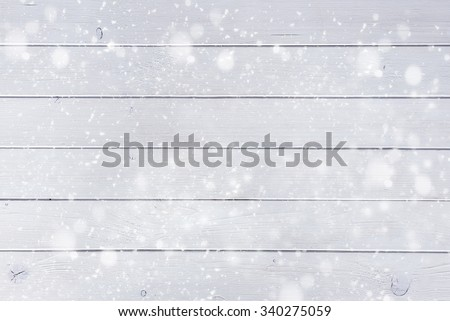 white wooden planks under the snow like a beautiful christmas background - stock photo