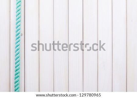 White wooden planks with rope background - stock photo