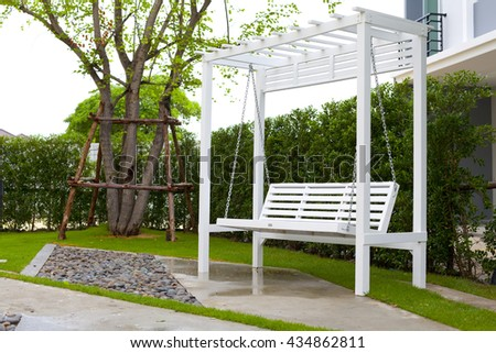 White wooden swing outdoor.