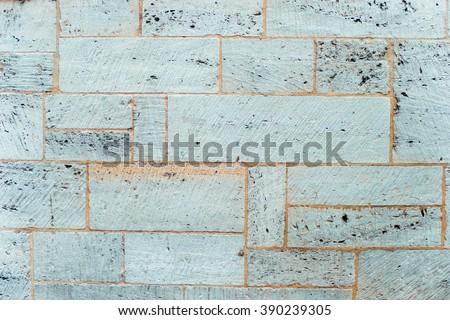 White worn marble sandstone brick old brick tile wall texture. Vintage effect.  - stock photo
