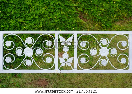 white wrought iron bench in the park - stock photo
