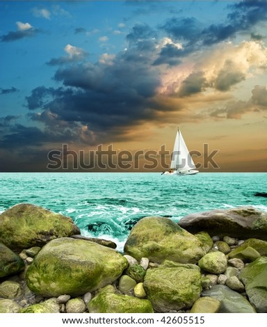 white yacht in a sea at the evening - stock photo