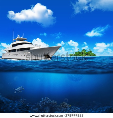 White yacht in the sea. Beautiful beach with palm trees on the horizon. Underwater turtle and coral. - stock photo