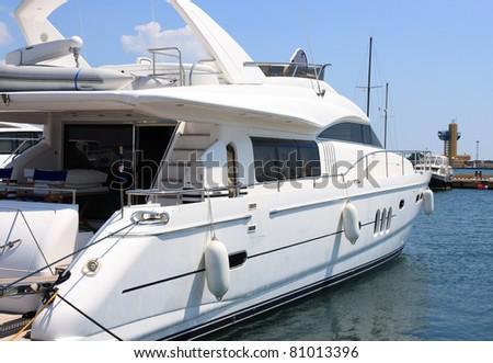 white yacht mooring in marina - stock photo