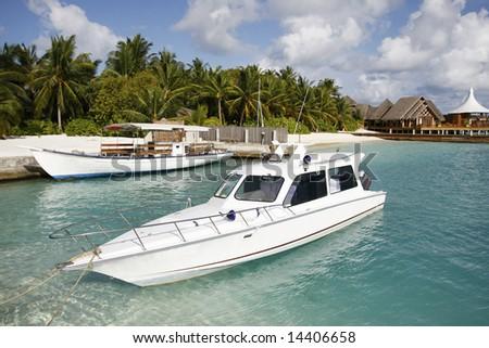 White Yacht Near A Tropical Beach - stock photo
