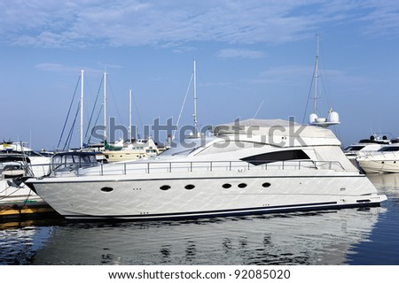 White yacht on an anchor in harbor - stock photo
