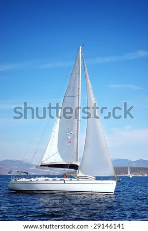 white yacht sail in the sea - stock photo