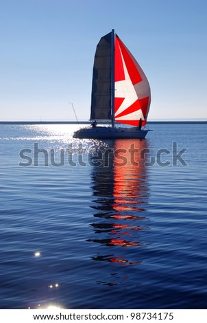 white yacht with red sail sailing - stock photo