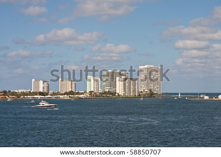 White Yachts in Shipping Channel past White Luxury Condo Towers