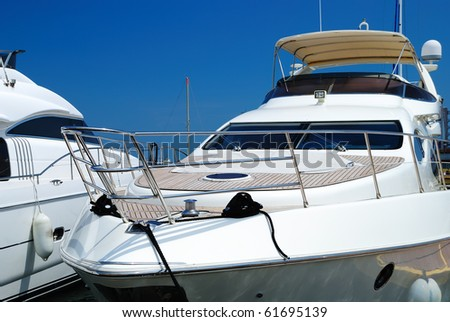 White yachts on an anchor in harbor - stock photo
