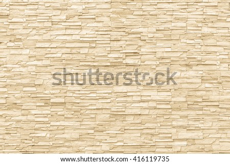 White yellow cream beige rock stone brick tile wall aged texture detailed pattern background: Grunge ancient rustic limestone stonework block masonry patterned backdrop for architectural decoration   - stock photo