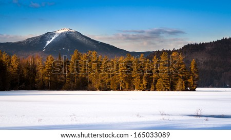 Whiteface mountain peak viewed from the frozen Paradox Bay in Lake Placid, Upstate New York - stock photo