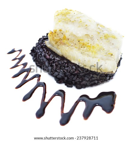 Whitefish with black rice and sauce on white background, lunch set, main menu dish with trimming, close up - stock photo