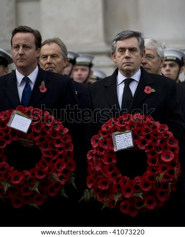 WHITEHALL, LONDON - NOV 8: Leader of the Conservative Party David Cameron (L) and Prime Minister Gordon Brown attend the Royal British Legion Remembrance Parade November 8, 2009 in Whitehall, London. - stock photo