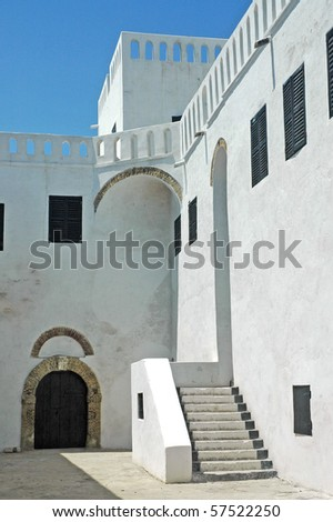 Whitewashed buildings and stairs in Elmina castle - stock photo