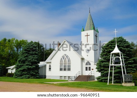 Whitewashed Church Against a Blue Sky in a Rural Midwestern Town - stock photo