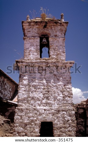Whitewashed church belltower in poor South American village