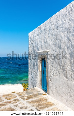 Whitewashed house at seaside in Mykonos, Greece, Europe - stock photo