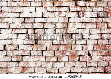 Whitewashed old red brick wall - stock photo