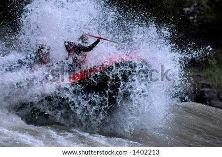 whitewater raft exploding through river wave - stock photo