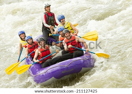 WHITEWATER RAFTING BOAT, GROUP OF SEVEN PEOPLE  - stock photo